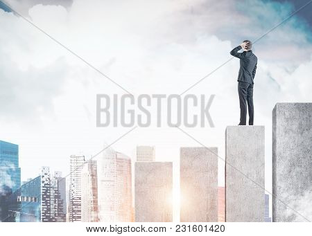 Rear View Of A Confused Businessman Scratching His Head And Thinking. He Is Standing On A Giant Bar