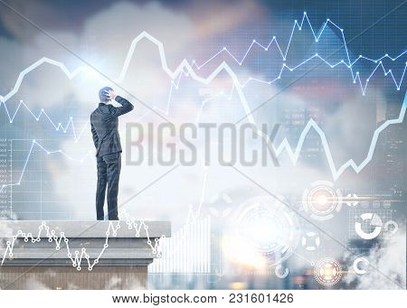 Rear View Of A Confused Businessman Scratching His Head And Thinking Standing On A Roof. Graphs And