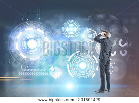 Rear View Of A Confused Businessman Scratching His Head And Thinking. Hud And Futuristic Background.
