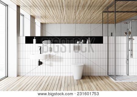 Interior Of A Modern Bathroom With White Tiled Walls, A Round Sink, A Shower Stall And A Toilet. 3d