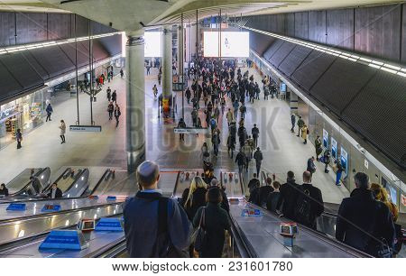 London, Uk- Mar 13, 2018: Escalator Towards Canary Wharf Underground Station With Commuters At Rush