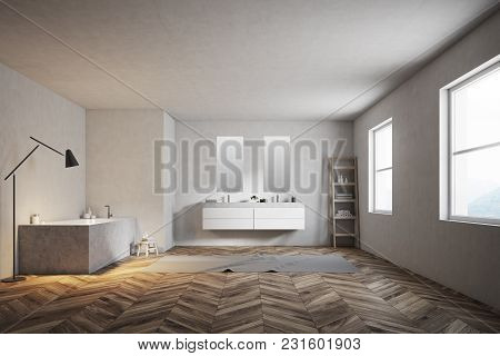 Luxury Bathroom Interior With An Angular Tub, A Double Sink With Two Narrow Vertical Mirrors And A W