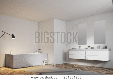 Angular Bathtub And A Double Sink In A Modern Bathroom With A Wooden Floor And White Walls. A Side V