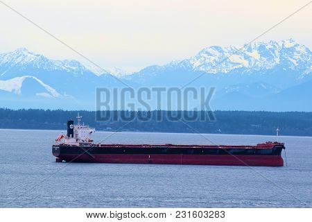 March 7, 2018 In Seattle, Wa:  Freighter Ship Docked At The Port Of Seattle Waiting To Pick Up Cargo