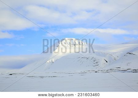 Snow-covered Mountain At Spitsbergen, In Svalbard, Norway