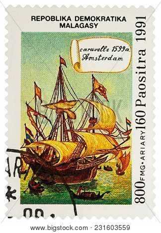 Moscow, Russia - March 16, 2018: A Stamp Printed In Madagascar Shows Sailing Ship, Caravel Amsterdam