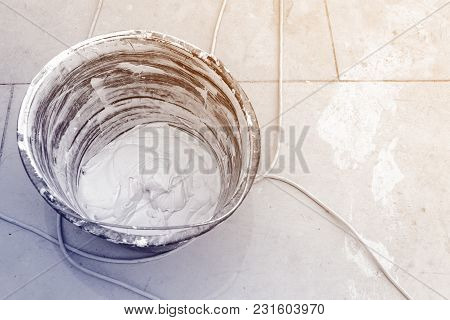 Bucket With Putty Ane Electric Wires Are On The Floor Room Of Apartment Is Under Construction, Remod