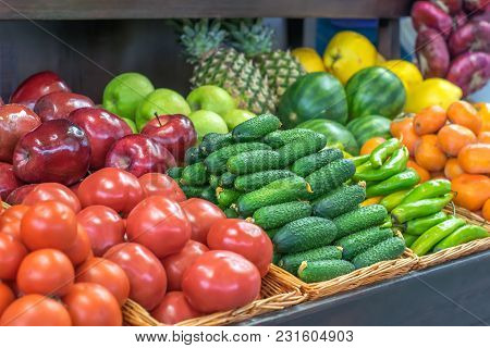 Raw Fresh And Healthy Fruits And Vegetables Cucumbers Tomatoes Apples, Persimmons And Tangerines Are