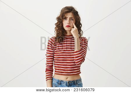I Need A Shoulder To Cry On. Studio Shot Of Attractive Gloomy European Girl Student Being Sad And Wi