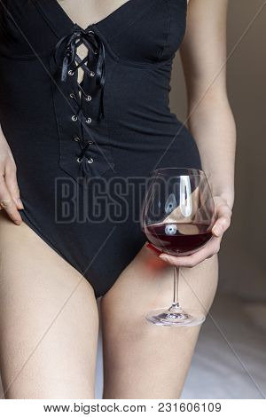 Closeup Of A Woman In Underwear With Red Wine
