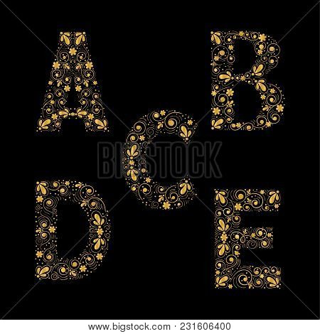 Gold Letters A, B, C, D, E On A Black Background