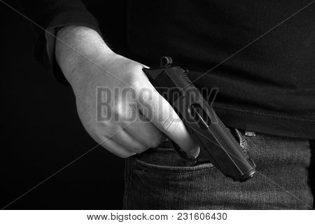 Mafioso Holds Pulled Out Gun, Isolated On Dark Background Back And White Photo