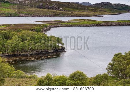Balgy, Scotland - June 10, 2012: Closeup Of Peninsula In Silver Colored Upper Loch Torriden. Green H