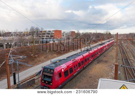 Hoje Taastrup Denmark - February 27. 2018: Danish Local Train Arrives To Hoje Taastrup Train Station