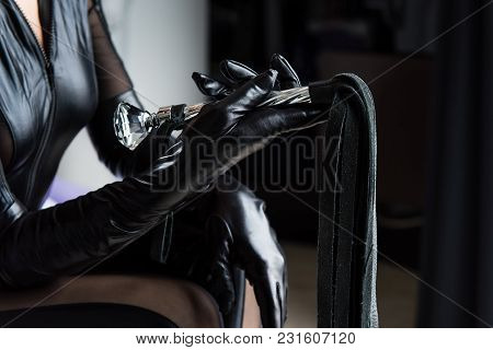 Black Leather Gloves And Whip With Fringe And Handle. Mistress With A Whip. Female Hand Hold Beautif