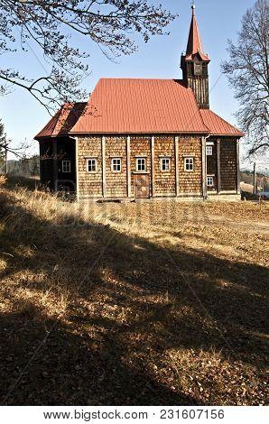 Wooden Church From 19th Century On Grun With Clear Sky In Moravskoslezske Beskydy Mountains In Czech