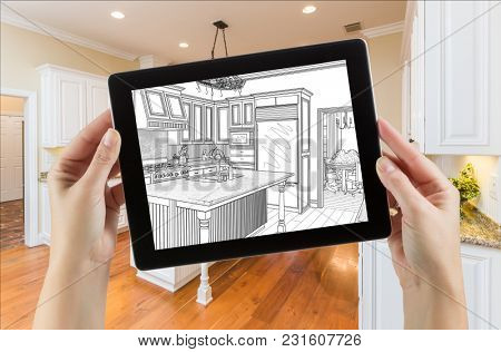 Female Hands Holding Computer Tablet with Drawing on Screen of Kitchen Behind.
