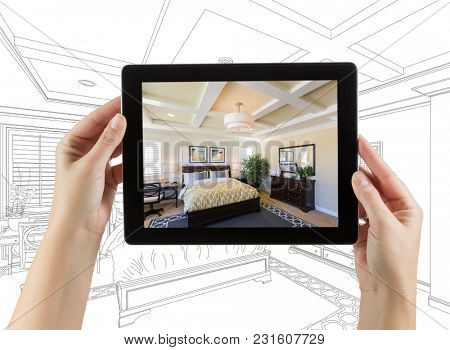 Female Hands Holding Computer Tablet with Bedroom Photo on Screen, Drawing Behind.