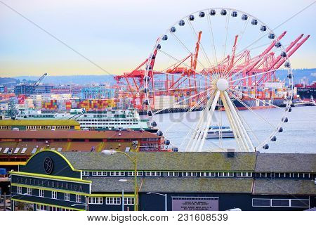 March 7, 2018 In Seattle, Wa:  Seattle Waterfront Including An Aquarium And A Large Ferris Wheel Cal