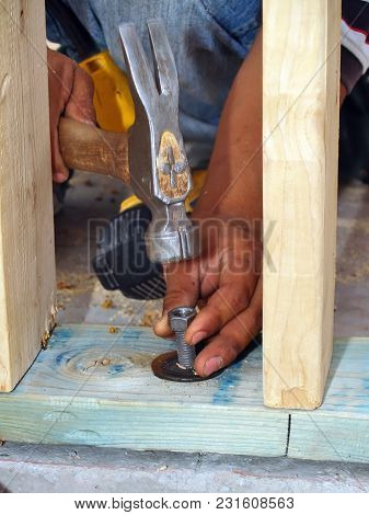 An Unusual Method Of Getting A Nut Started On A Bolt. If The Nut Cannot Be Rotated Onto The Bolt Thr