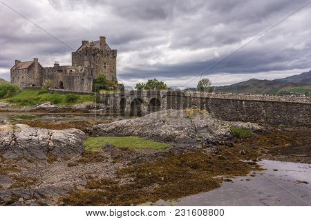 Dornie, Scotland - June 10, 2012: Entire Eilean Donan Castle With Footbridge Linking Green Island To