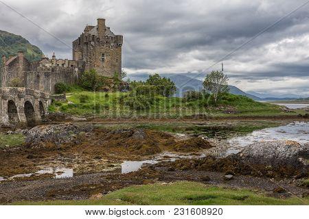 Dornie, Scotland - June 10, 2012: Footbridge, Linking Green Island To Mainland, Leads To Brown-stone
