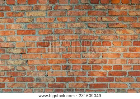 Background Of An Old Wall Piled With Red Bricks