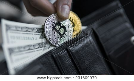 Golden And Silver Bitcoins And Hundred Dollar Bills In Leather Wallet. Bitcoin With Dollar In Purse.
