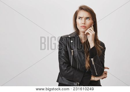 Hard Question Bothered Her Mind. Portrait Of Confused And Doubtful Good-looking Woman Looking Up, Fr