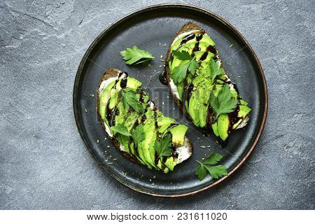 Avocado Toasts With Soft Cheese And Greens.top View With Copy Space.