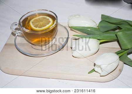 Tulips And Fresh Tea. Shallow Depth Of Field.