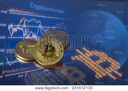 Golden Bitcoins On High Tech Blue Background