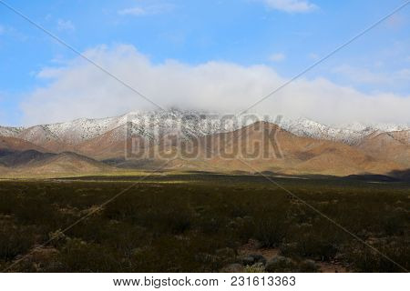 Clark Mountains with snow on the California - Nevada desert border. Mohave Desert and Death Valley Mountains.