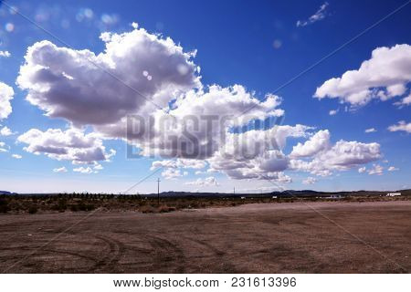 Blue Sky with white fluffy clouds. Mohave Desert with Blue Sky and White Clouds, Death Valley with blue sky and clouds.