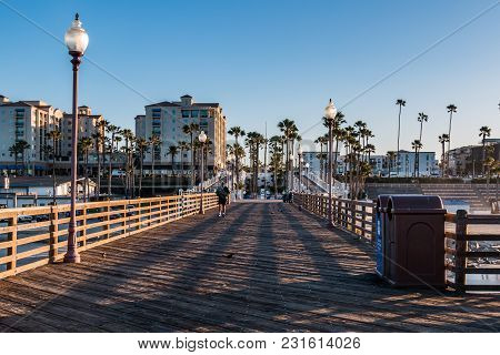 Oceanside, California/usa - February 24, 2018:  A Man Begins An Early Morning Walk On The Oceanside