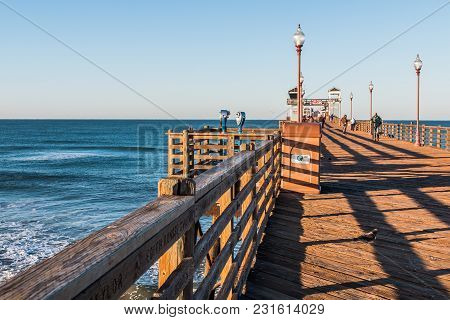 Oceanside, California/usa - February 24, 2018:  People Enjoy Views Of The Ocean On A Clear Morning F