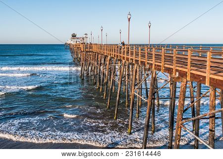 Oceanside, California/usa - February 24, 2018:  People Enjoy The View As They Walk The Length Of The