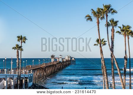 Oceanside, California/usa - February 24, 2018:  People Walk Among The Shops And Restaurant On Oceans