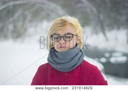 Soft Portrait Of Odd Lonely Girl Sitting In Winter Snowy Forest. Friendless Female Person With Sad E