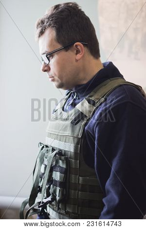 Photo Of Soldier In Safety Glasses And Armor
