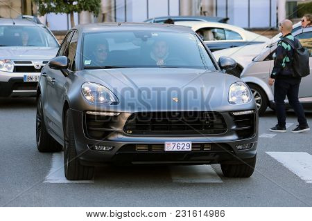 Monte-carlo, Monaco - March 17, 2018: Man Driving An Expensive Black Porsche Macan In Front Of The M