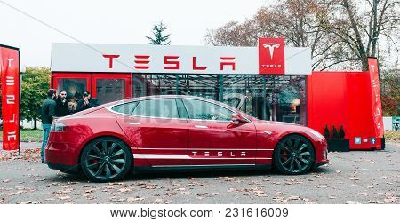 Paris, France - Nov 29, 2014: New Tesla Model S Showroom Parked In Front Of The Red Showroom With Cu