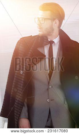 portrait of serious businessman in black coat