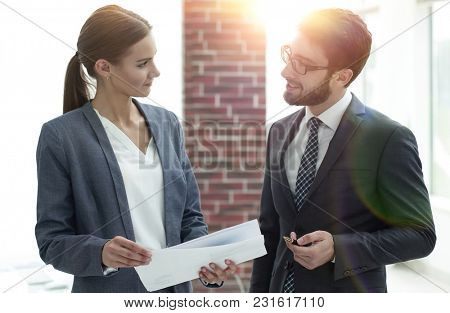 colleagues discussing business documents