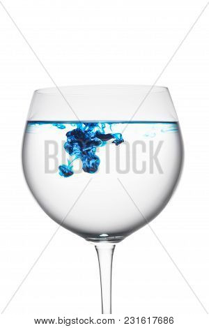 Food Coloring Diffuse In Water Inside Wine Glass Area For Slogan Or Advertising Text Message, On Whi