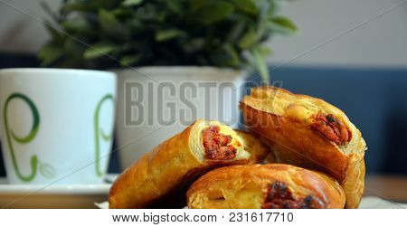 Pizza Small Scrolls Food With Coffee. Delicious Salted Breakfast.