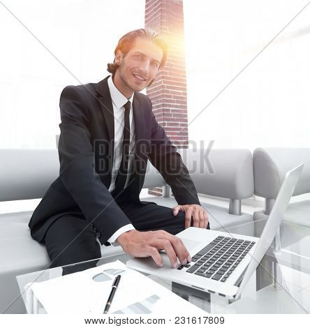 successful businessman working in his office.