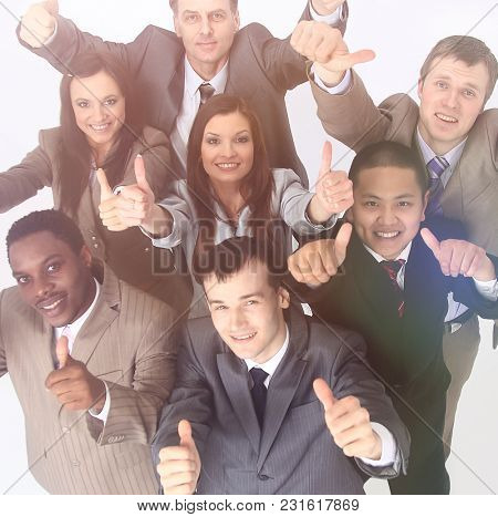multicultural business team with thumbs up