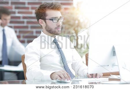 Manager works on a computer