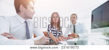 business team sitting at Desk